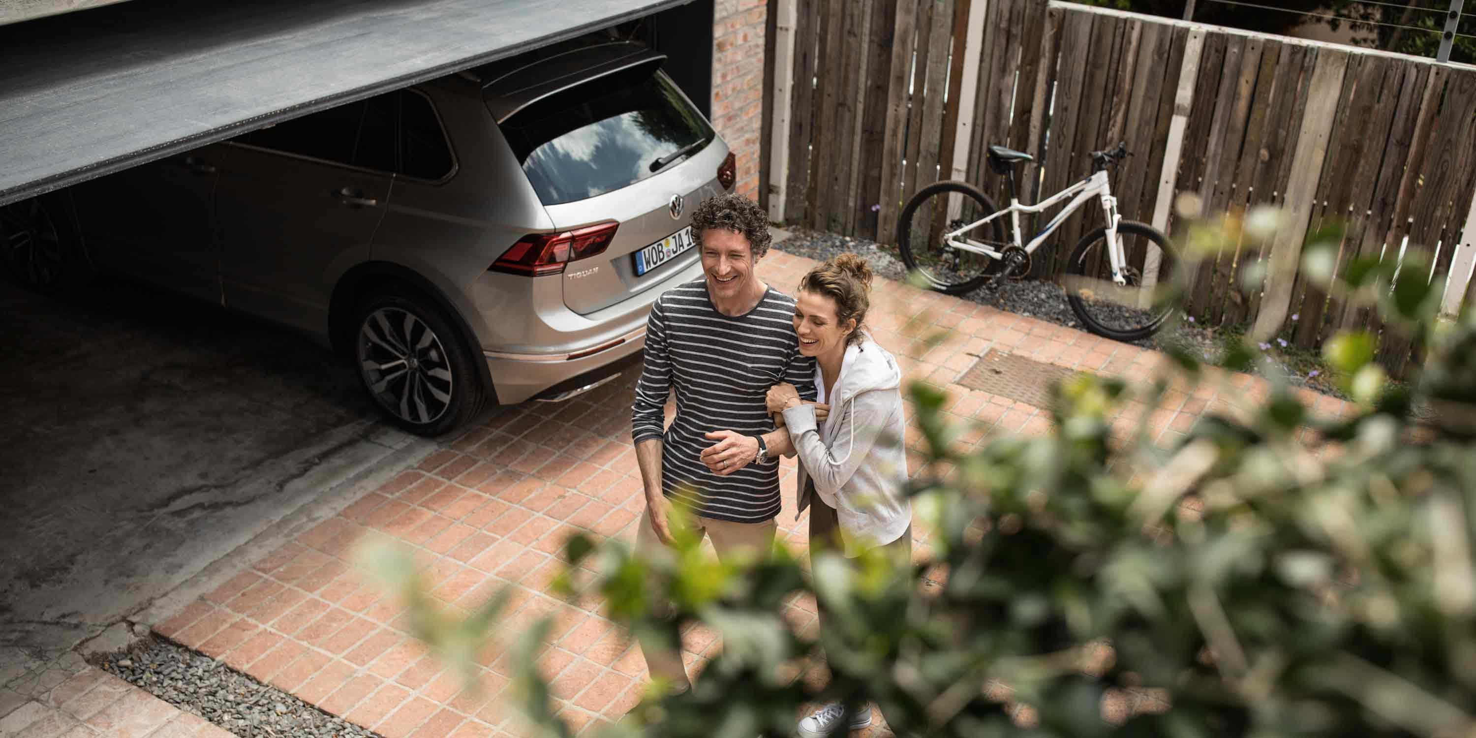 couple-standing-next-to-car